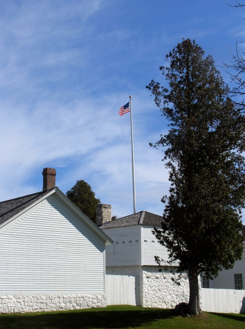 View of Post Schoolhouse (left) and North Blockhouse from outside Fort Mackinac's walls