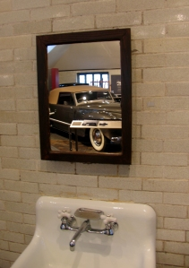 Edsel's Lincoln reflected in a garage mirror