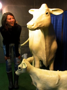 Paige chills with the Butter Cow and Calf in their refrigerated display case