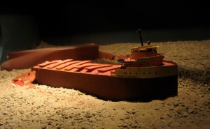 A model of the Edmund Fitzgerald as it lies broken, 550 feet beneath the surface of Lake Superior