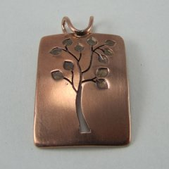 The tree is bare on the flip side of this copper pendant