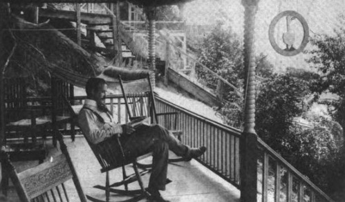 L. Frank Baum on the porch of his Sign of the Goose cottage at Lake Macatawa near Holland, Michigan